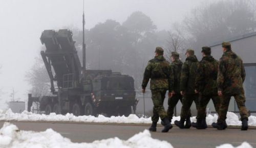 German soldiers walk past a PAC-3 launcher in December 2012 (Photo source: Reuters).